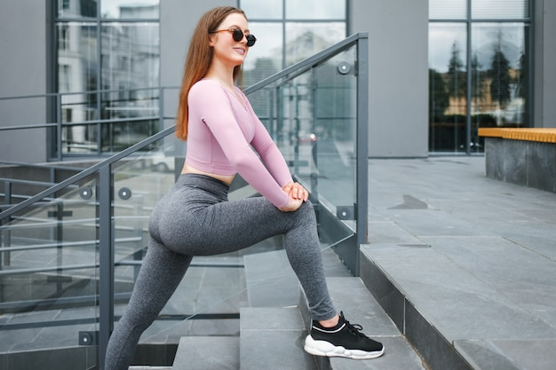 Girl doing stretching outdoors