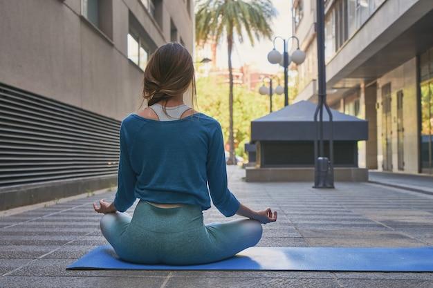 Girl doing yoga posture on the street