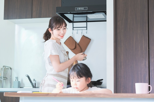 A girl drawing in the kitchen