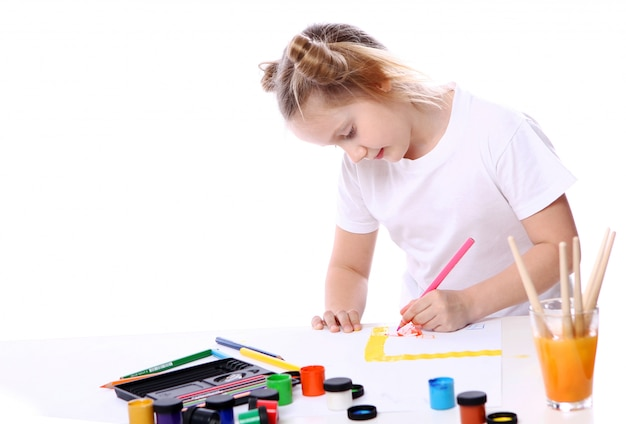 Girl drawing with brush and paint