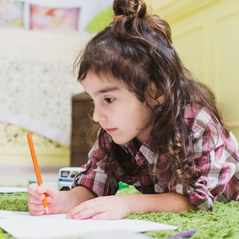 Girl drawing with pencil