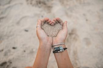 Girl draws on the sand