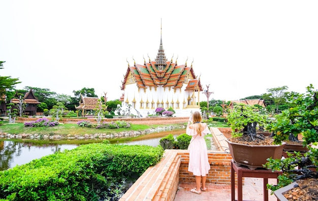 Girl in dress in front of the dusit maha prasat throne hall in thaliand