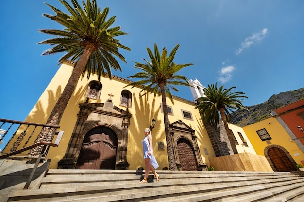 A girl in a dress on the steps of a church in the old town of garachico on the island of tenerife.canary islands.spain