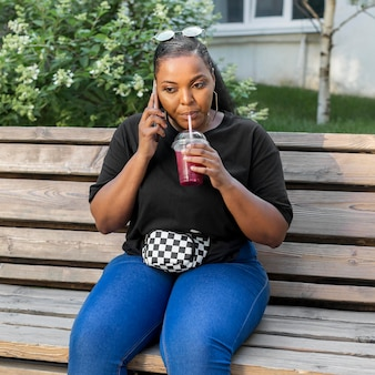 Girl drinking a smoothie outside