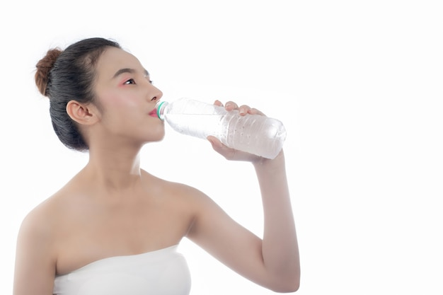 Girl drinking water on a white background.