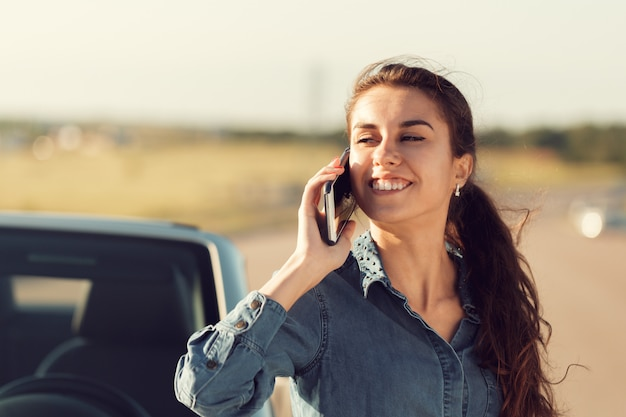 Girl driver with mobile phone