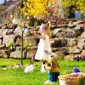 Girl on easter egg hunt with eggs