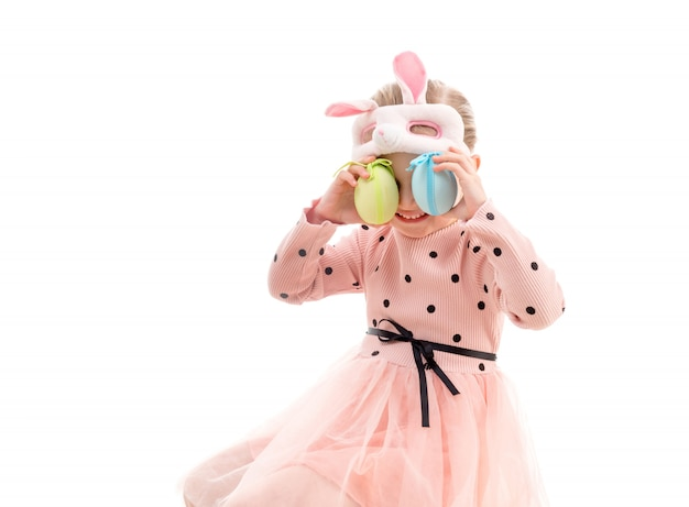 Girl in easter mask, eggs to eyes, isolated