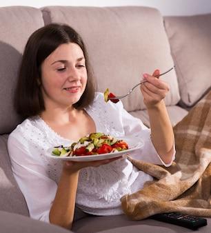Girl eating fresh salad