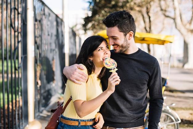 Girl eating lollipop with her boyfriend