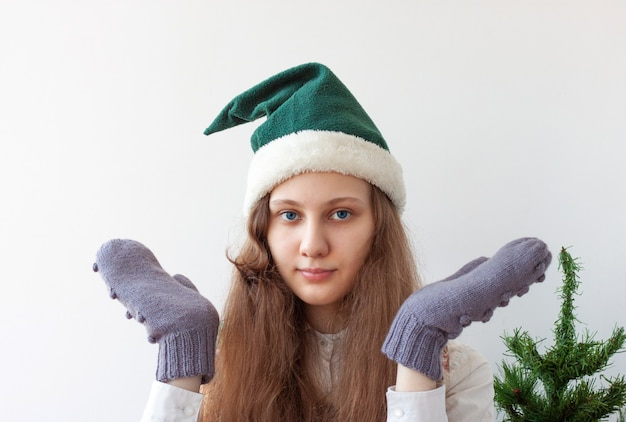 The girl in the elf's hat spread her arms to the sides.