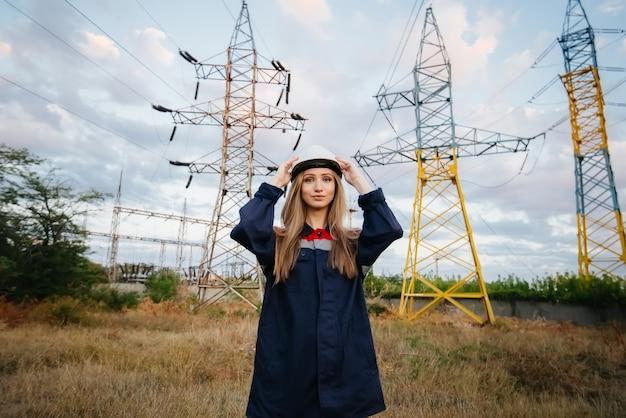 Girl energy worker wears a protective helmet. safety at work. energy.
