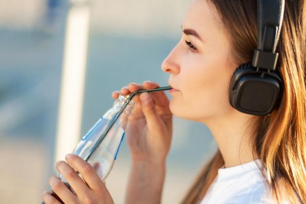 Girl enjoy drinking soda in listening music