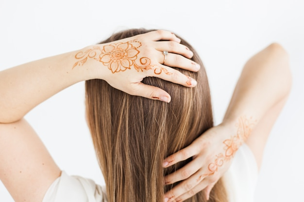 Girl of the european appearance posing with henna on hand