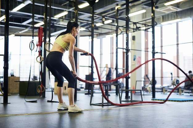 Girl exercising with ropes