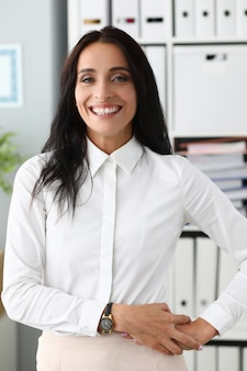 Girl in fashionable office clothes smiling widely