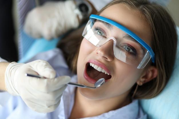 Girl feels comfortable at dental examination.