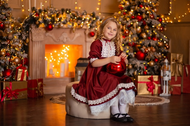 Girl in a festive dress with a gift