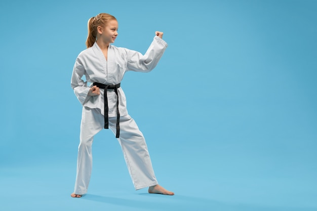 Girl in fighting stance of karate. concept of martial arts.