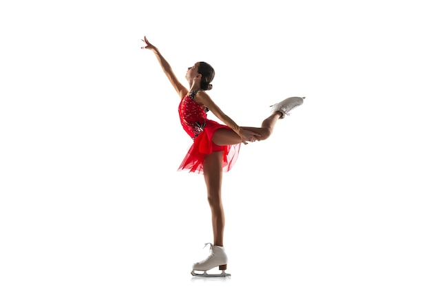 Girl figure skating isolated on white wall with copyspace.