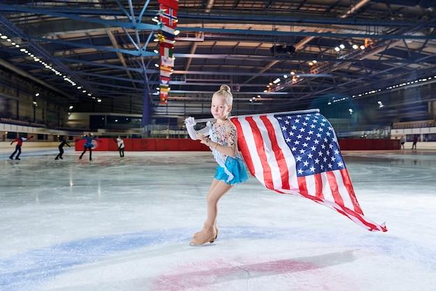アメリカの国旗とフィギュアスケートの女の子