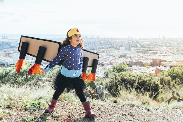 Girl flying disguised as a superhero with costume