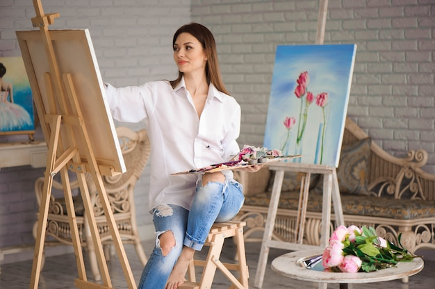 Girl focusing on art canvas while painting