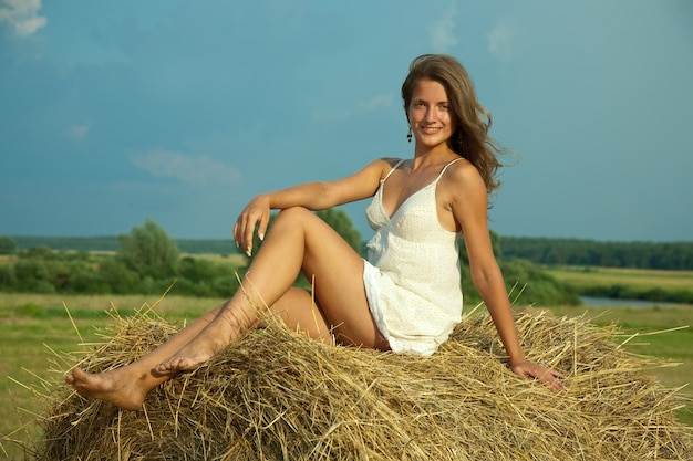 Girl  on fresh straw