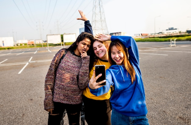 Girl friends smiling and taking a selfie together