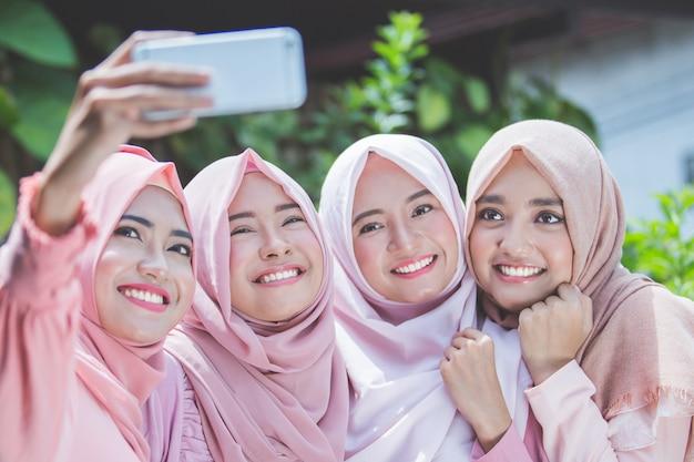 Girl friends taking selfie