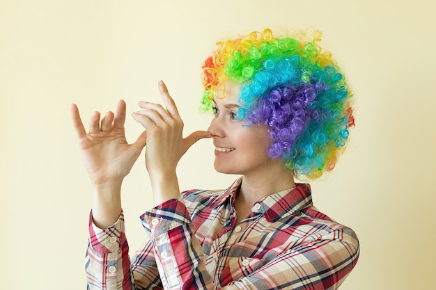Girl in funny wig fooling around, april fools day concept