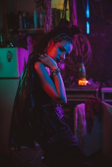 Girl in a futuristic cyberpunk costume with neon lighting. the concept of the future post-apocalypse. steampunk style
