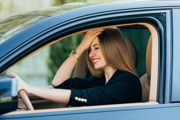 Girl gesture about mistake on road in drive car