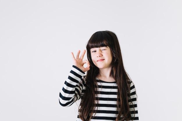 Girl gesturing ok