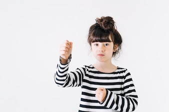 Girl gesturing with fists