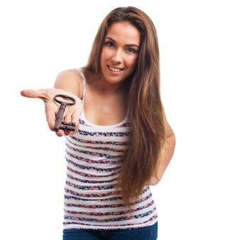 Girl giving a key