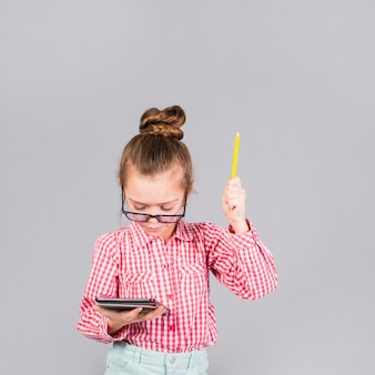 Girl in glasses with pen using tablet