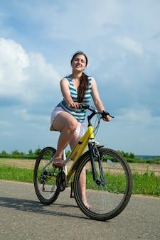 Girl goes on bicycle