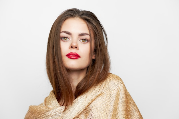 A girl in a golden scarf look forward model glamor fashionable style light space