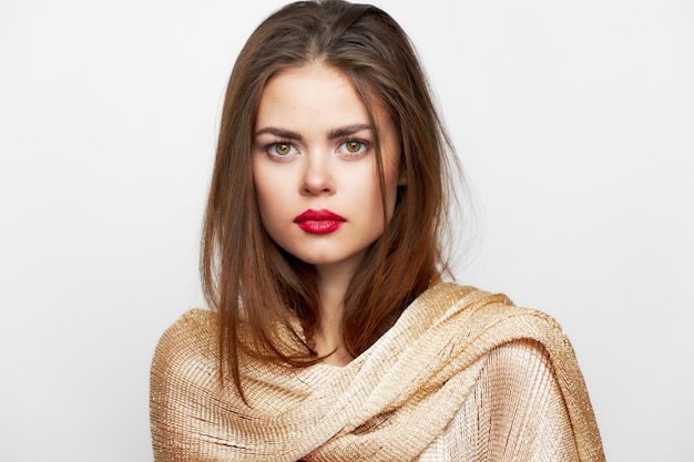 A girl in a golden scarf