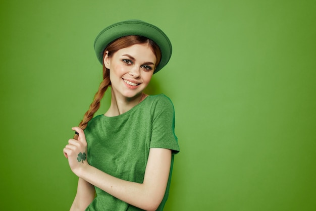 Girl in green clothes with hat for st. patrick's day