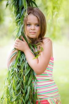 Girl in green leaves.