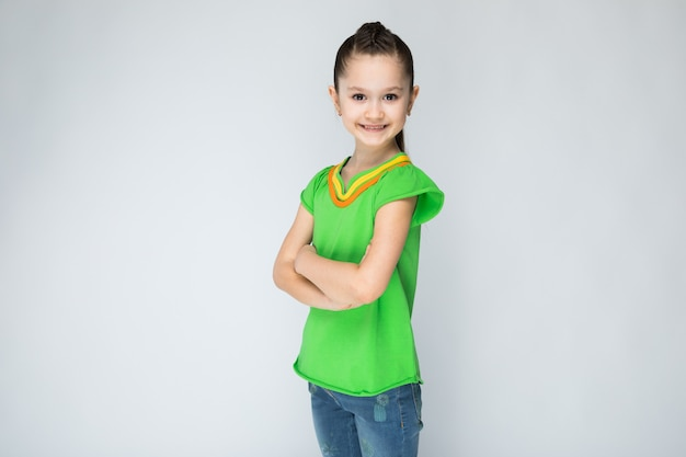 Girl in green t-shirt and blue jeans