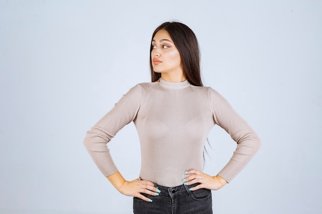 Girl in grey sweater giving nasty and seductive poses.