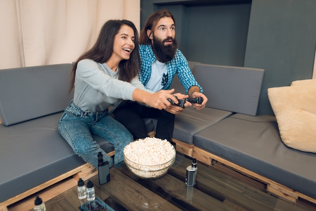 A girl and a guy play a game console.