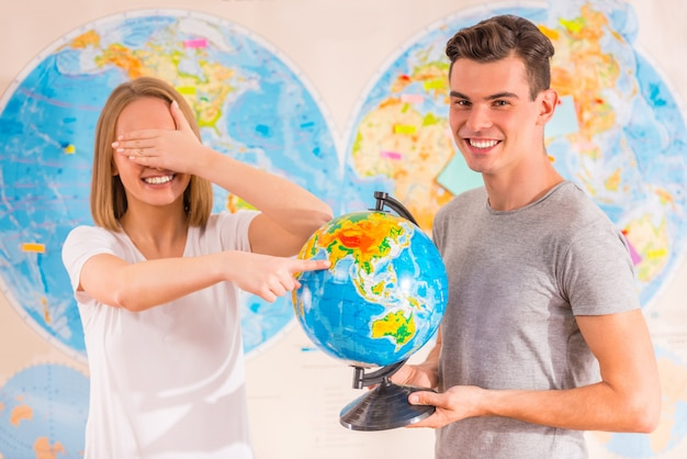 Girl and guy stand on the map.