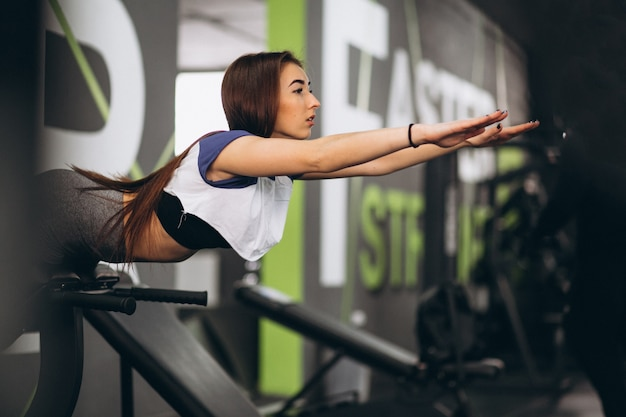 Girl at gym doing hyperextension