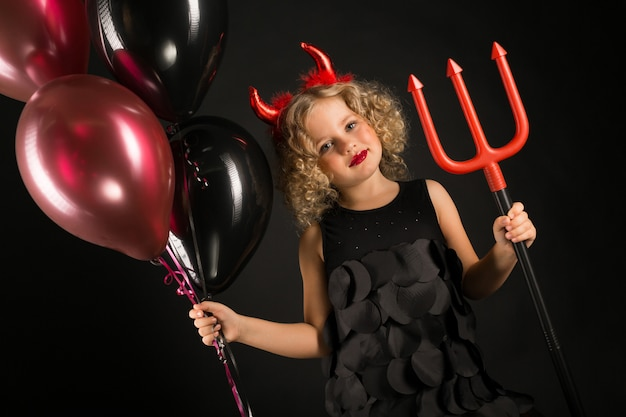Girl in halloween devils costume