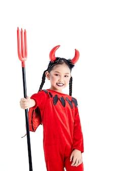 Girl in a halloween fancy dress devil